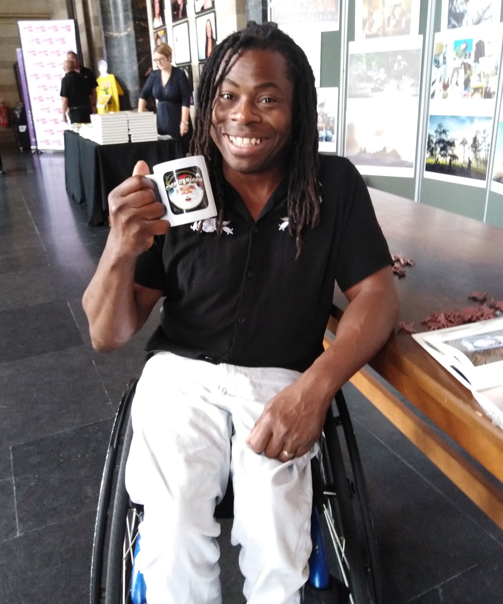 Ade Adepitan Television presenter - Santa Radio Celebrity Mugshots