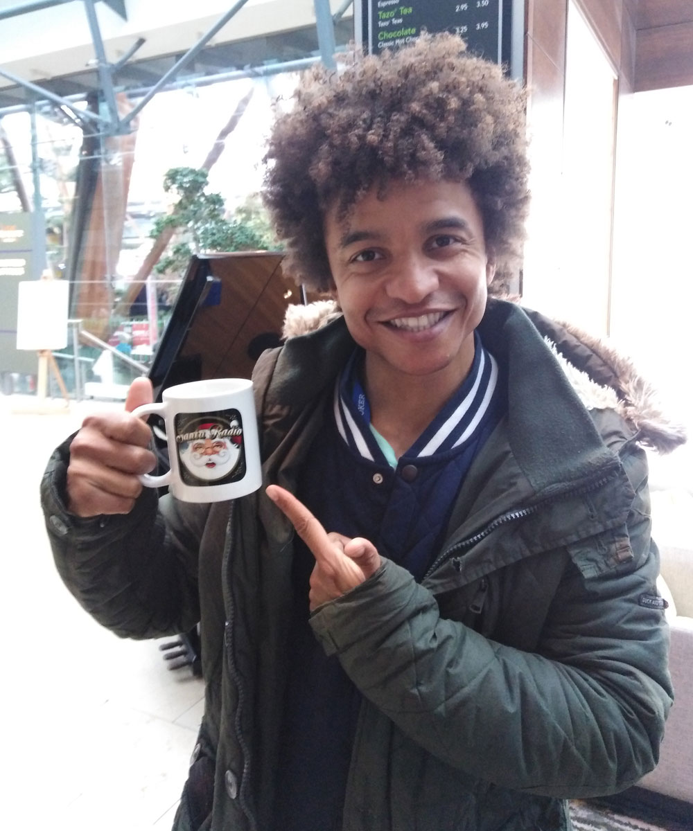 Radzi Chinyanganya British presenter - Santa Radio Celebrity Mugshots