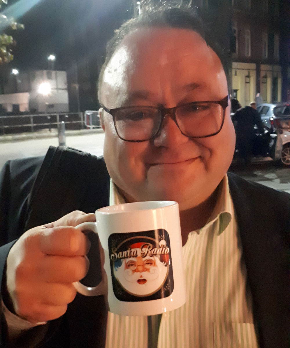 Toby Foster - Comedian, Actor & Radio Presenter - Santa Radio Mugshot
